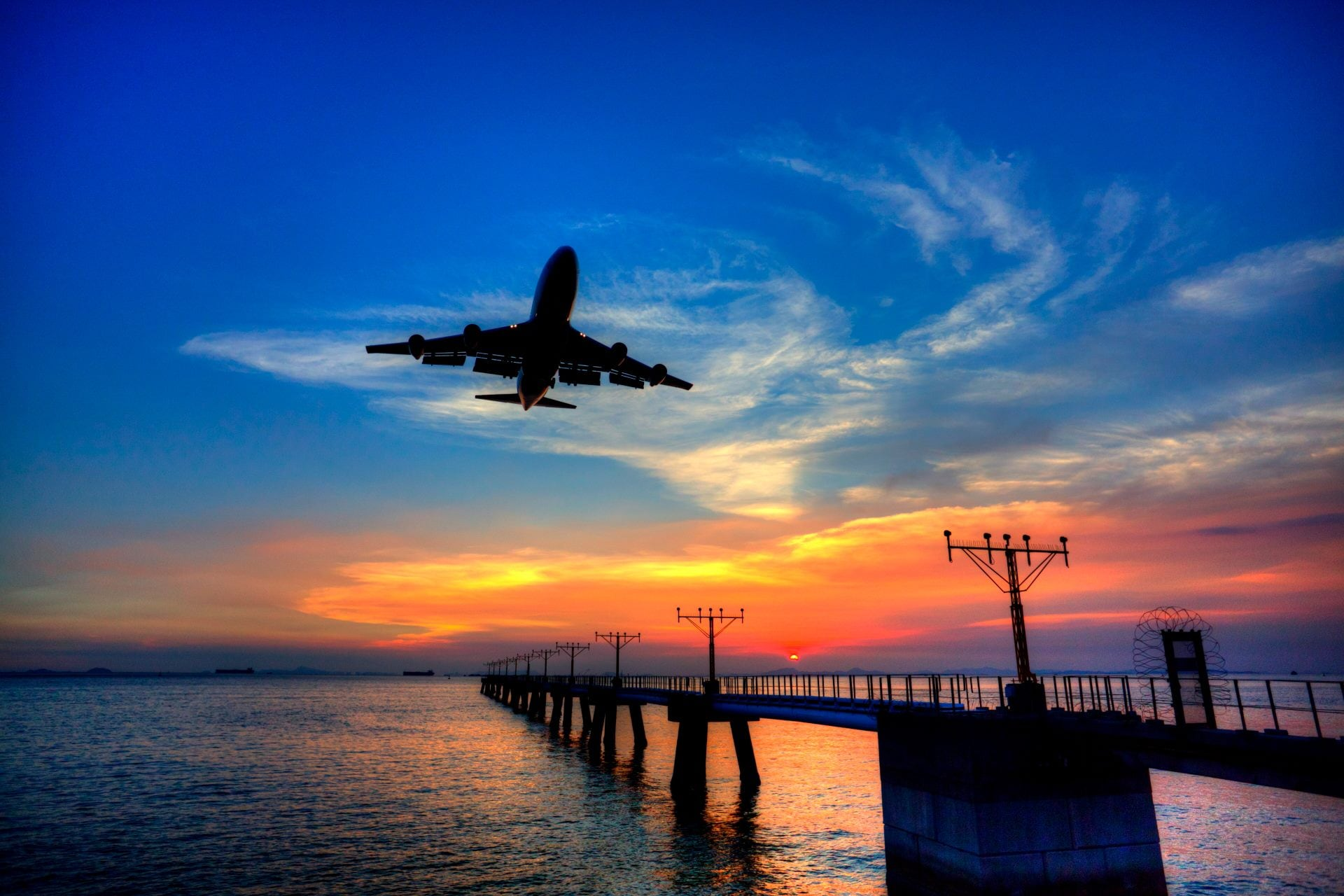 Aeronautical lights and airplane landing at Hong Kong International Airport